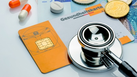 Stethoscope with health insurance card and pills